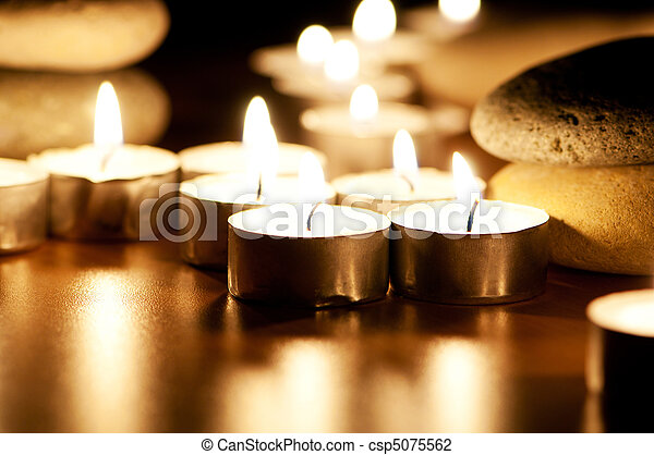 Burning candles and pebbles for aromatherapy session - csp5075562
