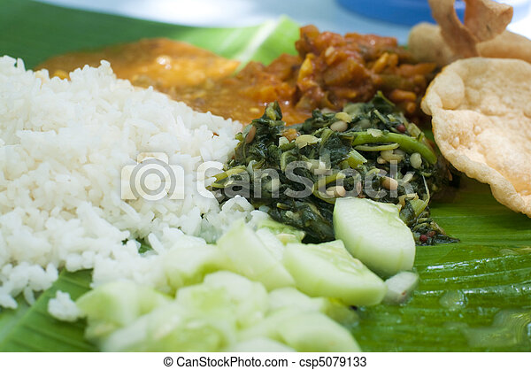 Indian cuisine banana leaf - csp5079133