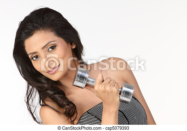 woman holding dumb bells  - csp5079393