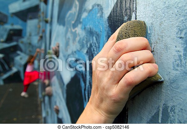 climbing holds learning climbers in colorful wall - csp5082146