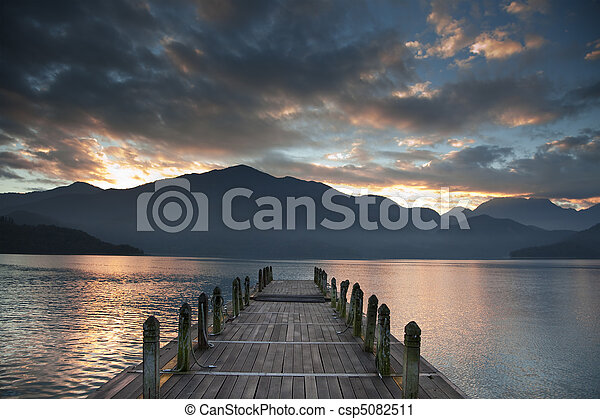 Sunrise over mountain and Looking over a pier - csp5082511