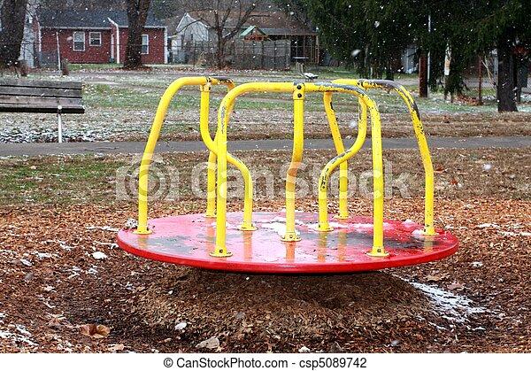 Merry Go Round in Park Snowing in W - csp5089742