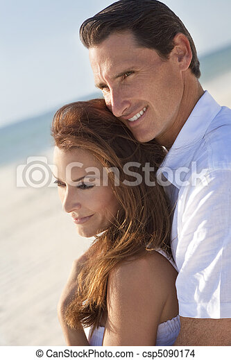 Romantic Couple Embracing on A Beach - csp5090174