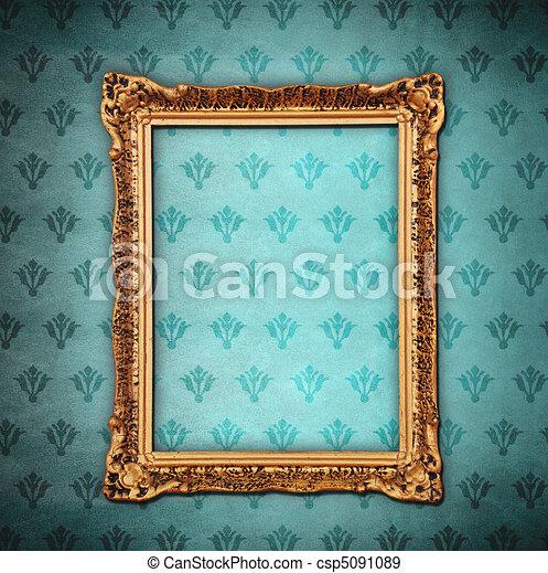 Golden frame over grunge wallpaper  - csp5091089