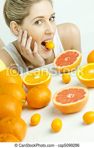portrait of young woman with citrus fruit - csp5099286