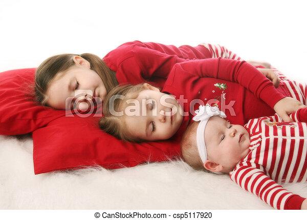Sleeping sisters waiting for Christmas - csp5117920