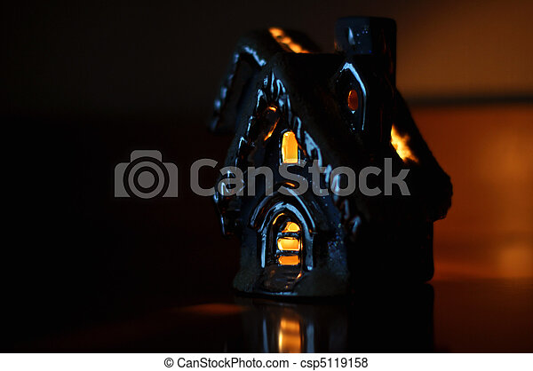 The house with lit lights in windows - csp5119158