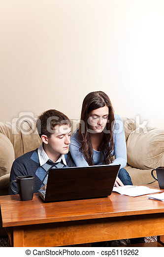 Couple paying bills by online banking - csp5119262