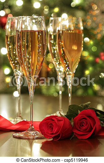 Glasses of champagne and red roses - csp5119946