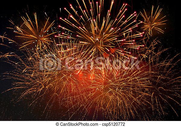 Bright festive fireworks against a black background sky