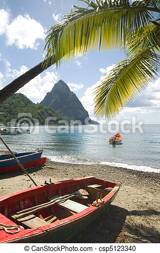 St. Lucia island view of famous twin piton mountain peaks from Soufriere beach native fishing boats in Caribbean Sea - csp5123340