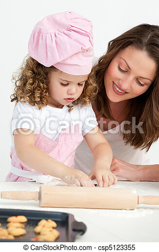 Little girl preparing a dough - csp5123355