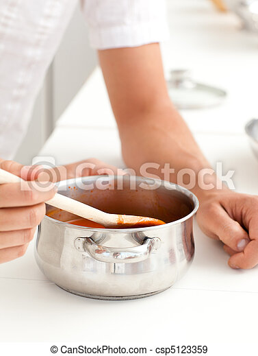Man and woman tasting a sauce - csp5123359