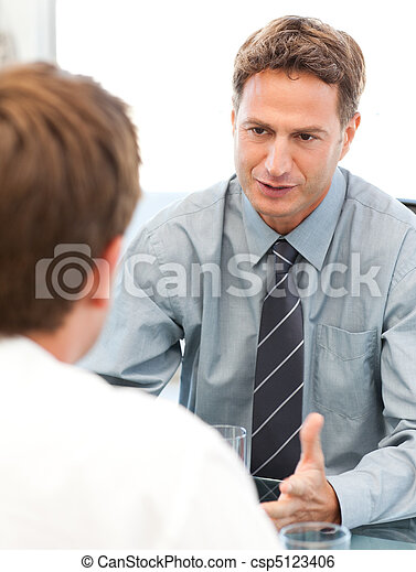 Charismatic manager during a meeting with an employee - csp5123406