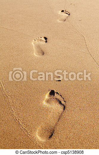 Three human footprints on the beach sand - csp5138908