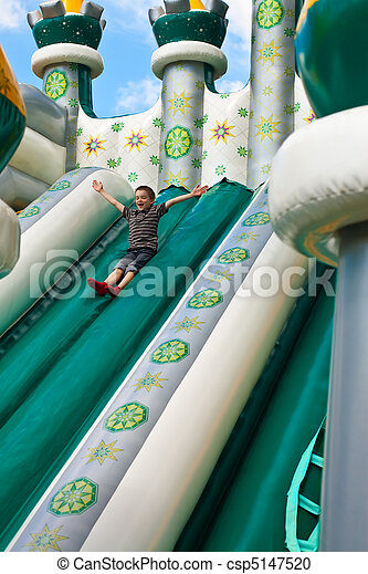 Boy in inflatable castle - csp5147520