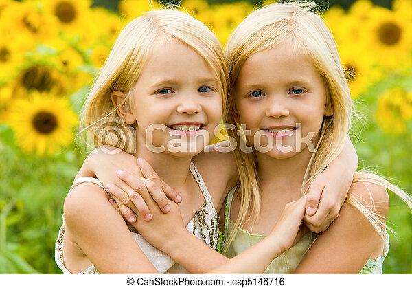 Hugging sisters - csp5148716