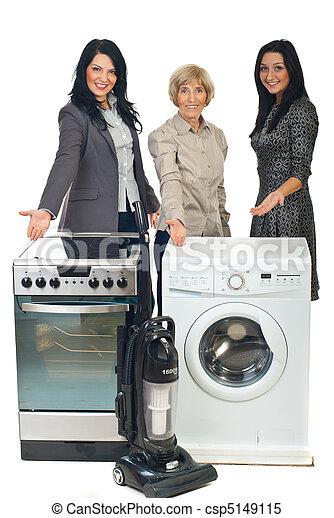 Three sales women showing to household appliances - csp5149115