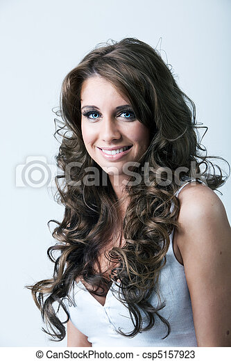 Portrait of woman with blue eyes and long curly hair - csp5157923