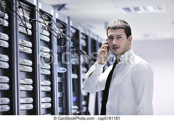 it engeneer talking by phone at network room - csp5161181