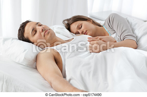 Cute couple sleeping together on their bed - csp5174490