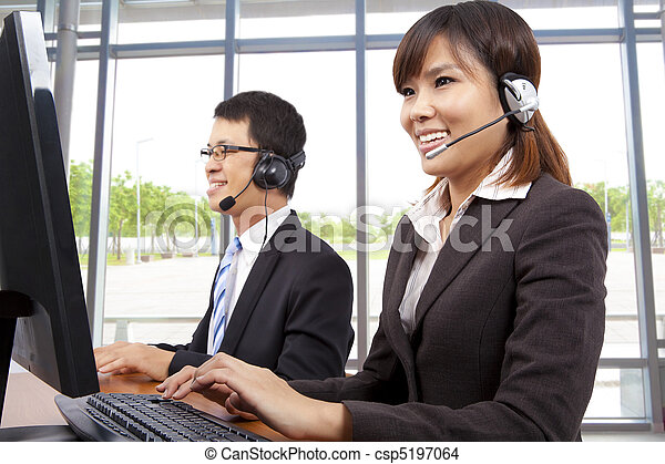 Smiling customer service representative in modern office with a headset   - csp5197064