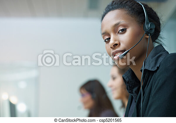 women working in call center - csp5201565