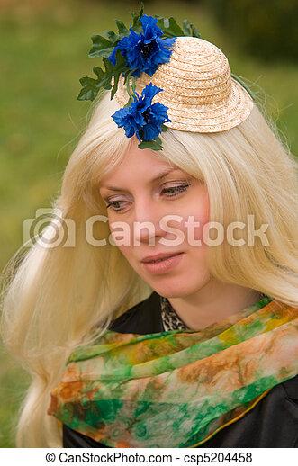 woman with a beautiful headdress - csp5204458