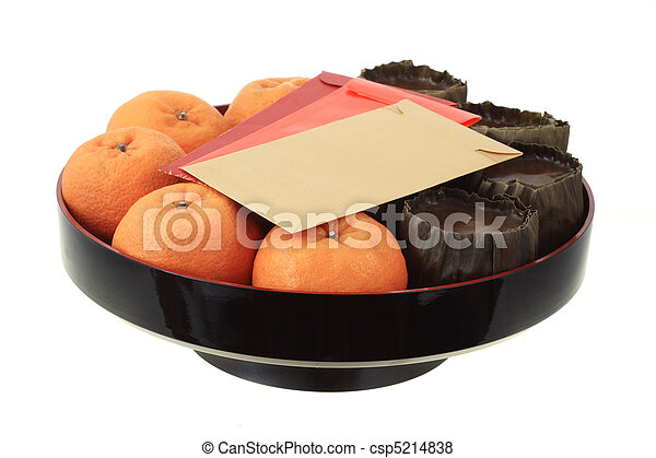 Chinese new year rice cake, mandarin oranges and red packets - csp5214838