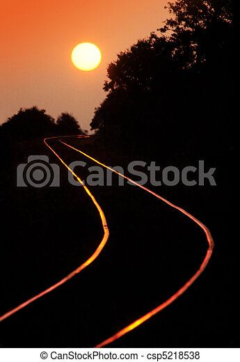 Railroad tracks at sunset - csp5218538