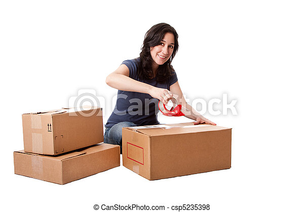Woman taping moving storage boxes - csp5235398