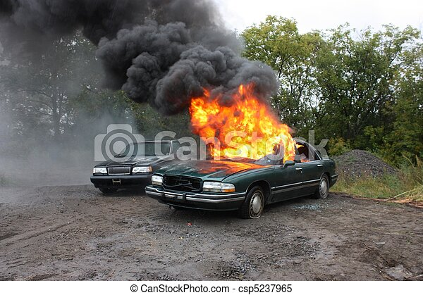 An automobile engulfed in fire. - csp5237965
