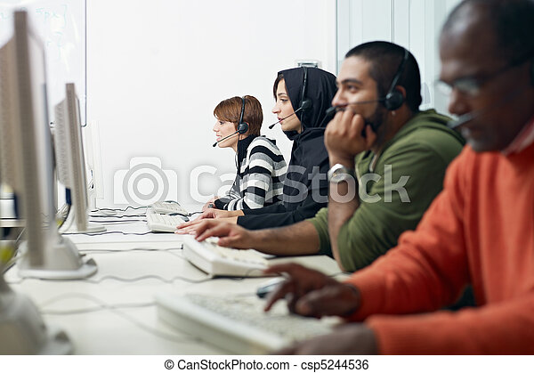 students with headset in computer lab - csp5244536