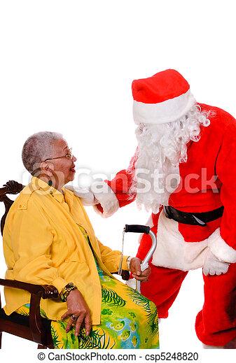 Santa and senior citizen - csp5248820