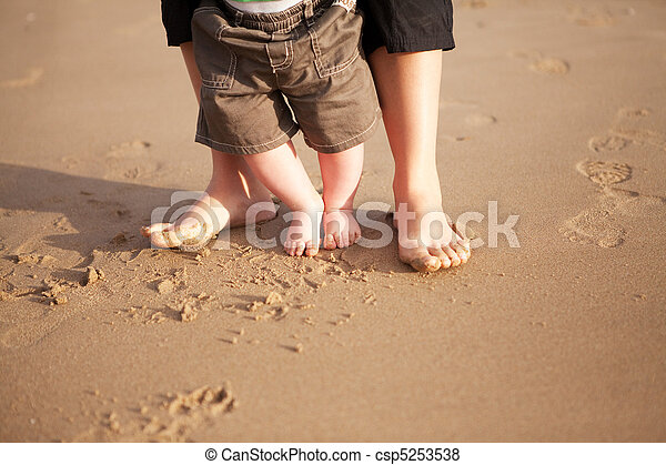Mother and baby walking on beach - csp5253538