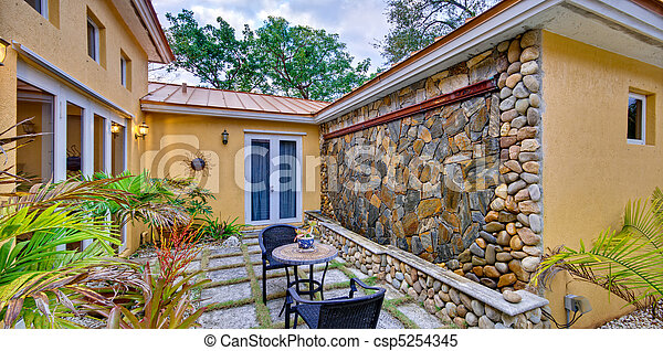 Lush landscaped patio - csp5254345
