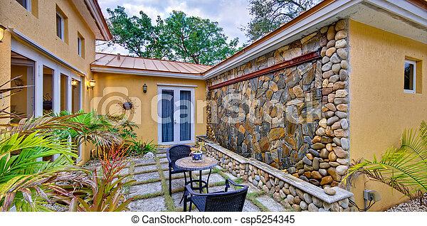 Lush landscaped patio - csp5254345