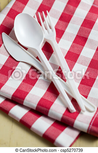 plastic cutlery on checkered tablecloth - csp5270739