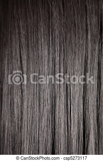 Texture of black shiny straight hair, soft focus