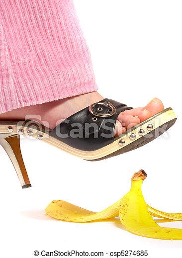 Female leg(foot) and peel of a banana. Life insurance. - csp5274685