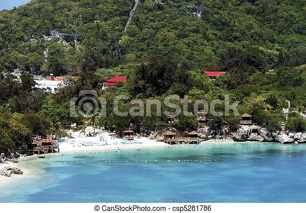 Wood Cabanas on a Sunny Tropical Beach - csp5281786