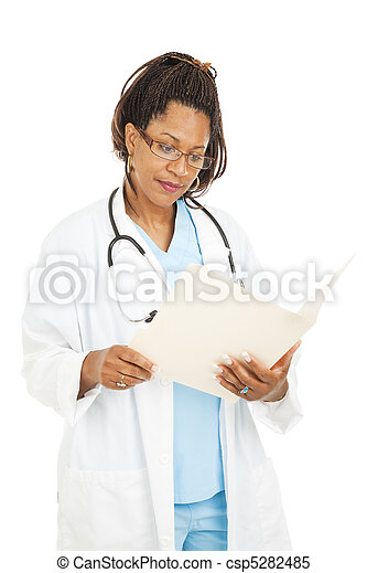 Pretty Doctor Reads Medical Chart - csp5282485