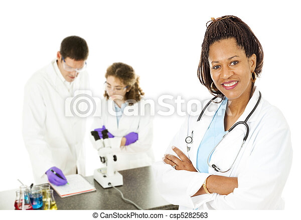 Female Doctor with Lab Techs - csp5282563