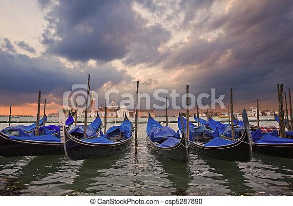 Gondolas bobbing in lagoon outside San Marco Piazza Venice Italy - csp5287890