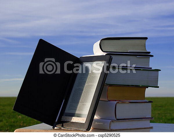 E-book reader and books - csp5290525