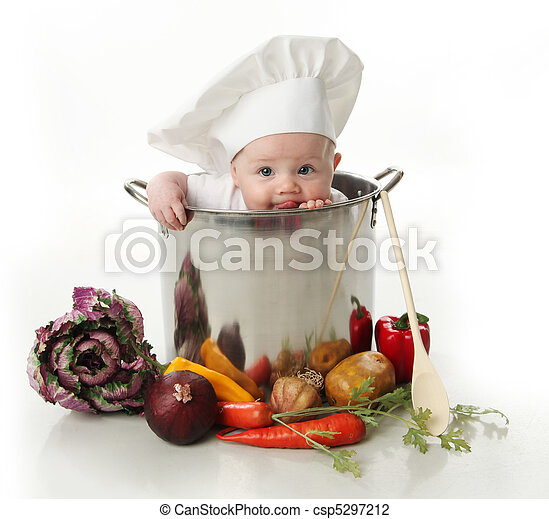Licking baby sitting in a chef's pot  - csp5297212