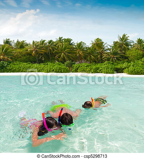 Children snorkeling in sea - csp5298713