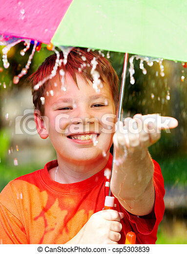 boy under an umbrella during a rain - csp5303839