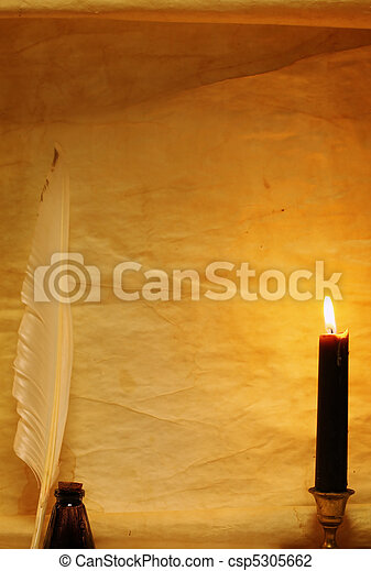 Paper, quill, & ink lit by candle - csp5305662