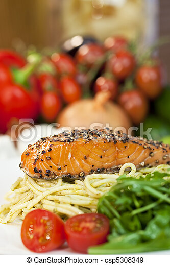 Peppered salmon fillet with spaghetti pasta tomatoes and green salad - csp5308349